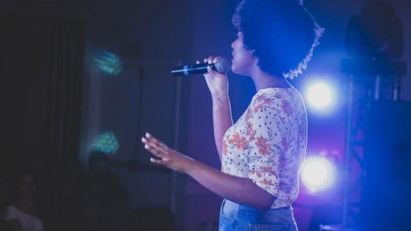 Young women singing in a karaoke
